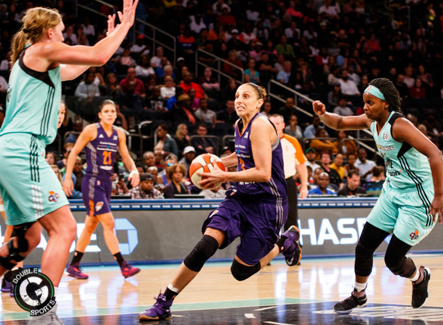 Diana Taurasi (center) splits New York Liberty defenders on her way to the basket. (Photo by Ralph DePiro - Double G Media)